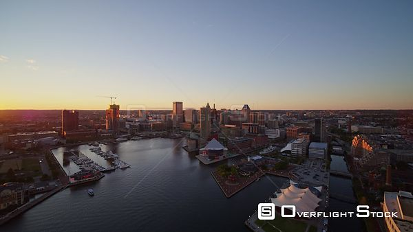 Baltimore Maryland Aerial Flying toward downtown over harbor with picturesque cityscape views to panning into sunset