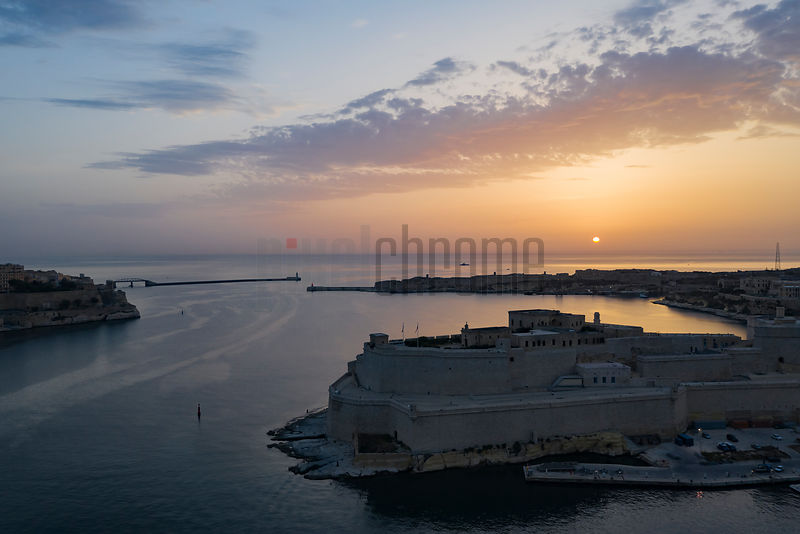 Hazy Sunrise over the Entrance to Valletta Harbour