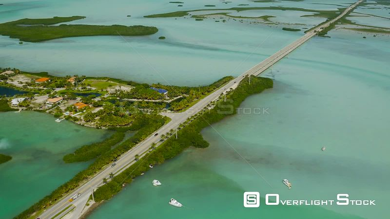 Flying besides Route 1 and Shark Key looking down panning. Florida Keys