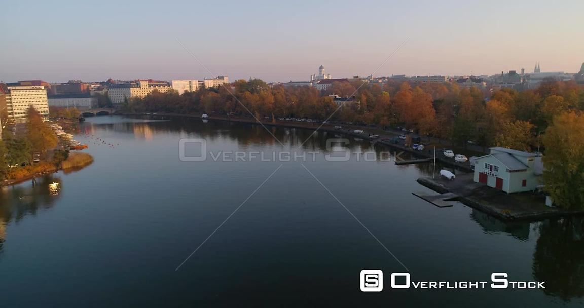 Helsinki cityscape, C4k aerial, rising drone shot, over elaintarhanlahti, revealing the cathedral and the Kaisaniemi park, on...
