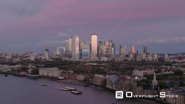 Canary Wharf financial district, filmed by drone in autumn, at sunset, London, United Kingdom