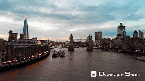 City of London Skyline and Tower Bridge, filmed by drone in autumn, at sunset, London, United Kingdom