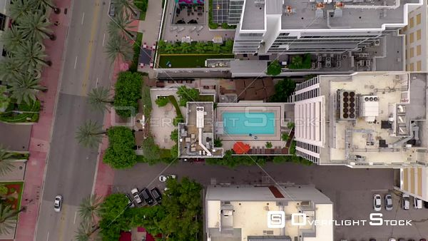 Aerial rising above hotel swimming pool 4k