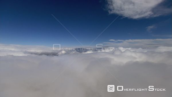 Flying above and and around cumulus clouds. Airplane Perspective