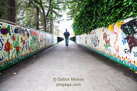 Graffitied bridge and man walking, Los Gatos, CA, USA