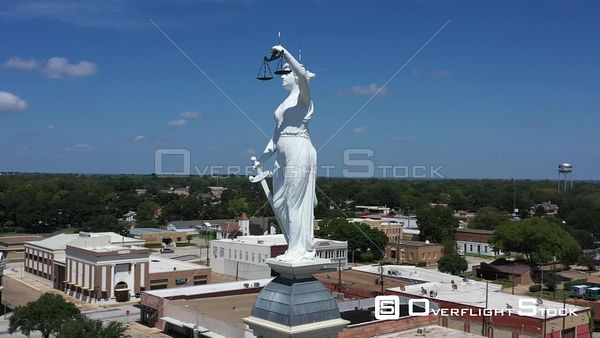 Lady Justice Statue above Downtown and the Courthouse, Cameron, Texas, USA