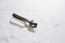 Vintage bottle Opener isolated diagonally.