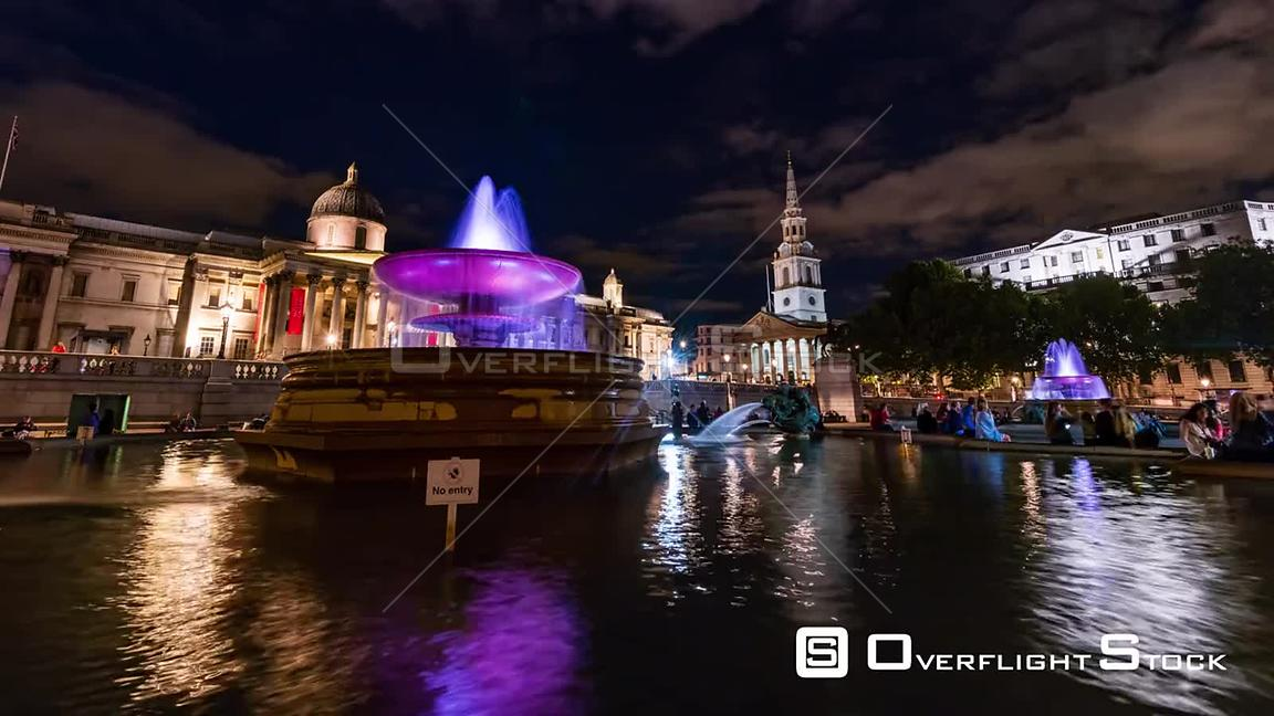 Time lapse view of Trafalgar square, London with fountains and the church of St Martin in the fields at night