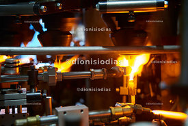 Flame production of glass in close