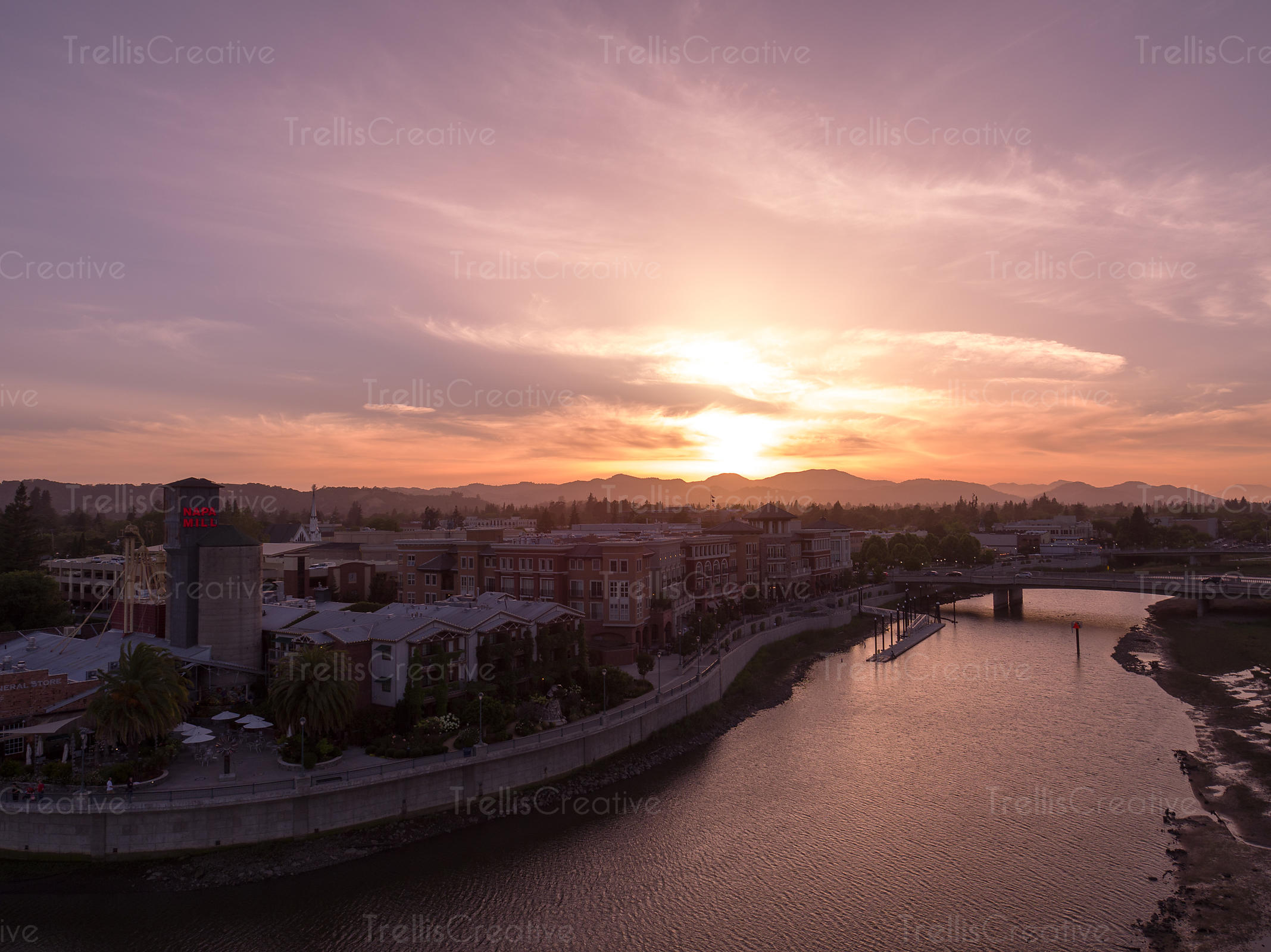 Drone aerial photo of Napa River flowing through the downtown Napa Waterfront, Napa Valley, California, USA.
