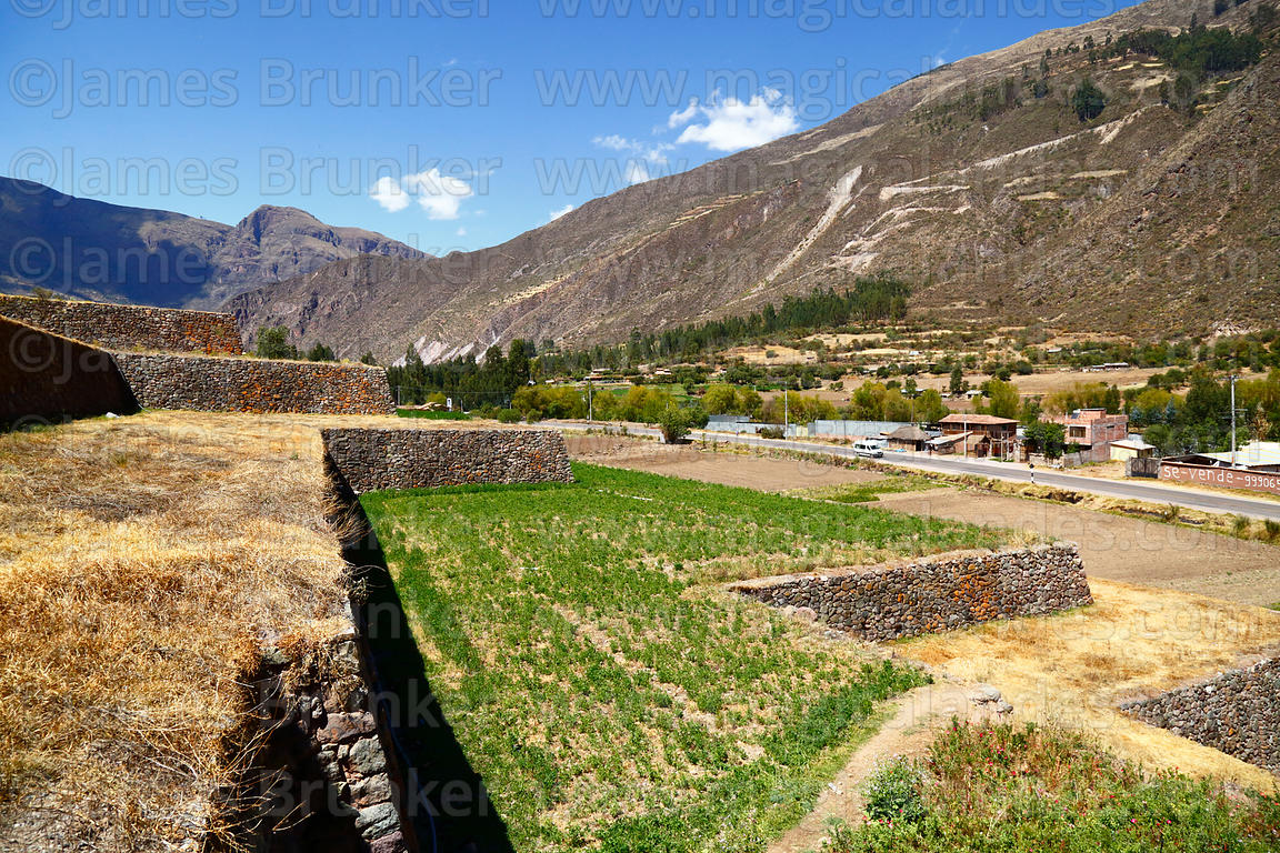 Large restored Inca agricultural terraces next to main road near site of Urco / Urqo, near Calca, Cusco Region, Peru