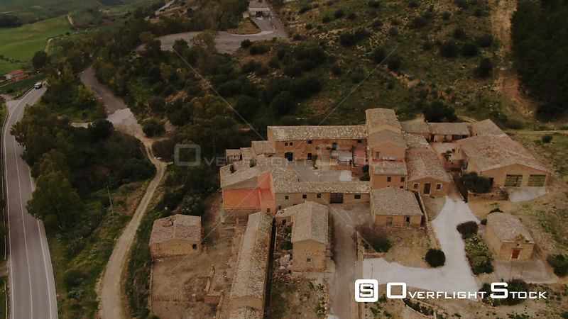 Aerial descending view of an abandoned rural village in Sicily. Italy