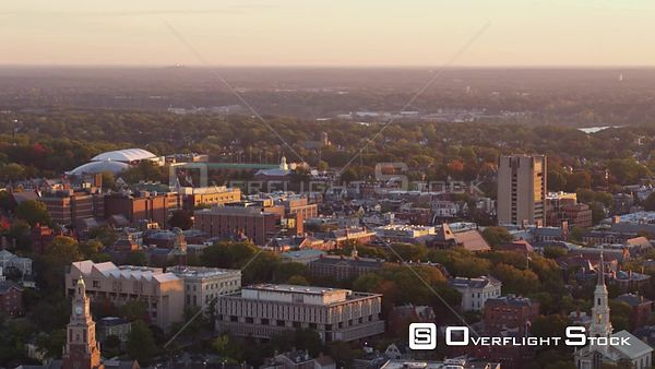 Providence Rhode Island Panoramic university campus cityscape flying in reverse at sunrise