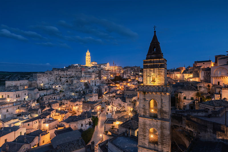 View of Matera with the Tower of the Church of San Pietro Barisano in the Foreground at Dusk