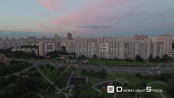Sunset Forward Flight Towards Residential Buildings in Moscow. Moscow Russia Drone Video View