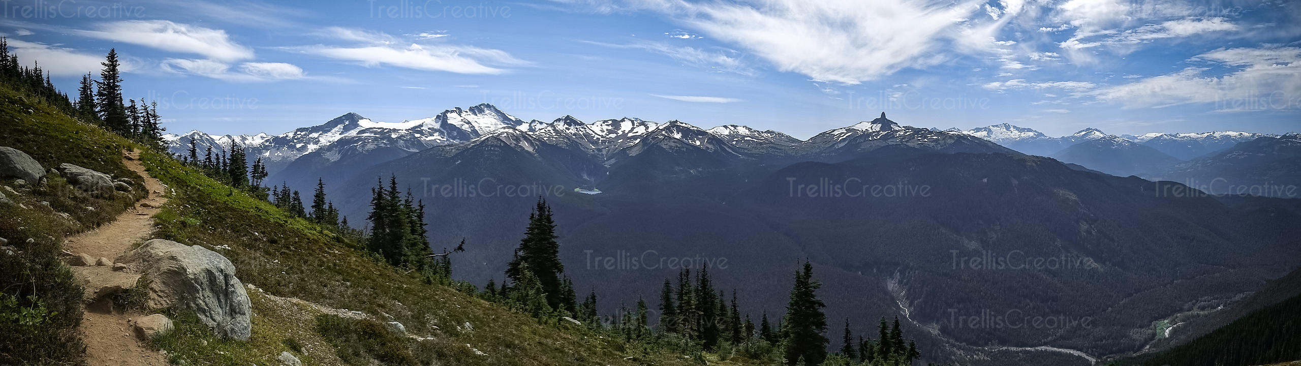 Panoramic view of a mountaintip hiking trail, Blackcomb Mountain, Whistler, Canada.
