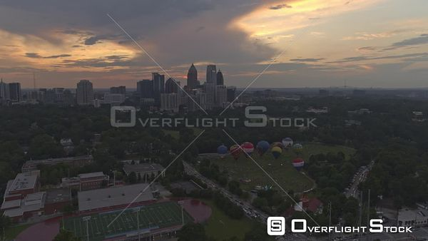 Atlanta Panning view of hot air balloons and midtown with sunset, dusk sky