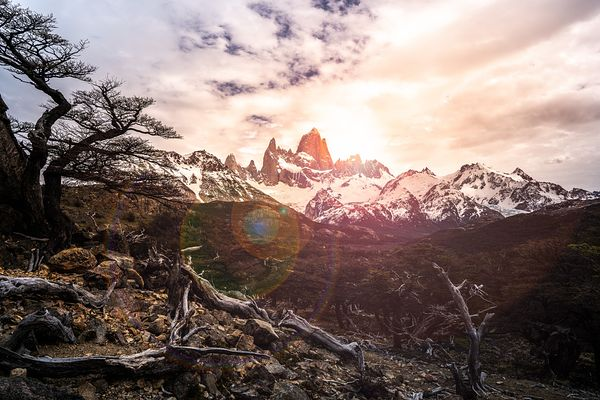 Sunshine breaks through storm clouds over the Fitz Roy Mountain peak in Argentina. Southern Patagonia