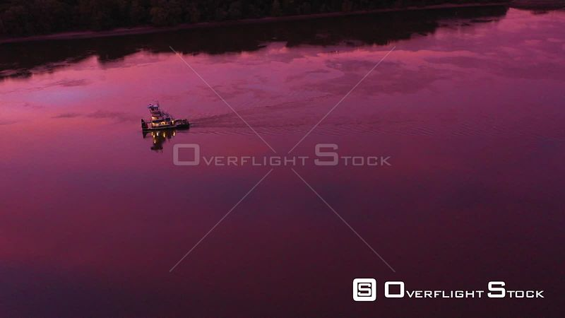 Sunrise Reflections with a Towboat on the Mississippi River, Dubuque, Iowa, USA