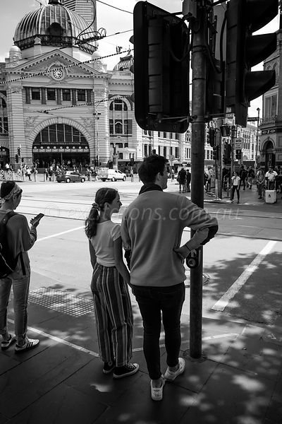 Waiting to cross road, Flinders Street Station.