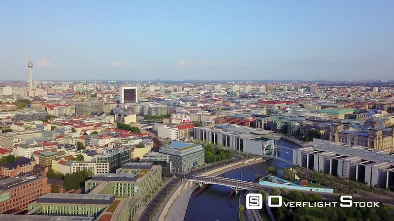 Germany Berlin Aerial Flying low around Spreebogen Park area with cityscape views