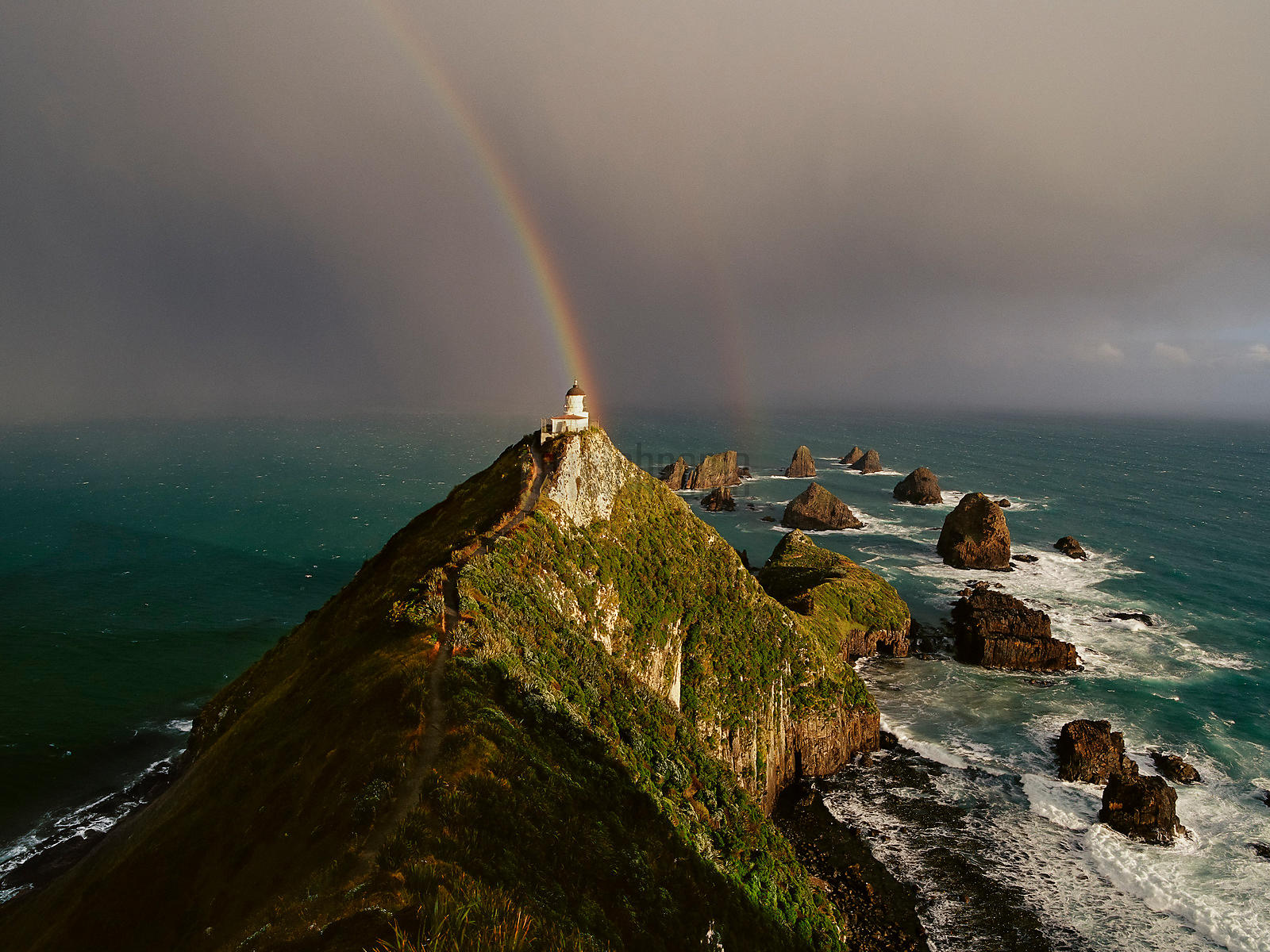 Rainbow at Nugget Point