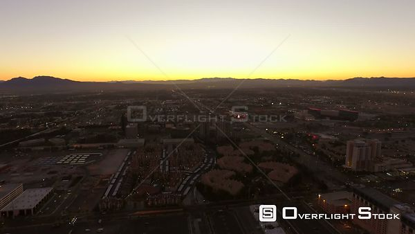 Low flying backwards aerial over high roller ferris wheel and strip. Las Vegas Nevada