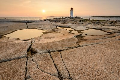 Smooth Granite rock at Peggy's Cove lighthouse during a beautiful sunset