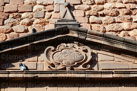 Detail of carved inscription above main entrance of Santa Teresa church, Cusco, Peru