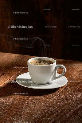 Coffee cup isolated on rustic wood background, vertically.