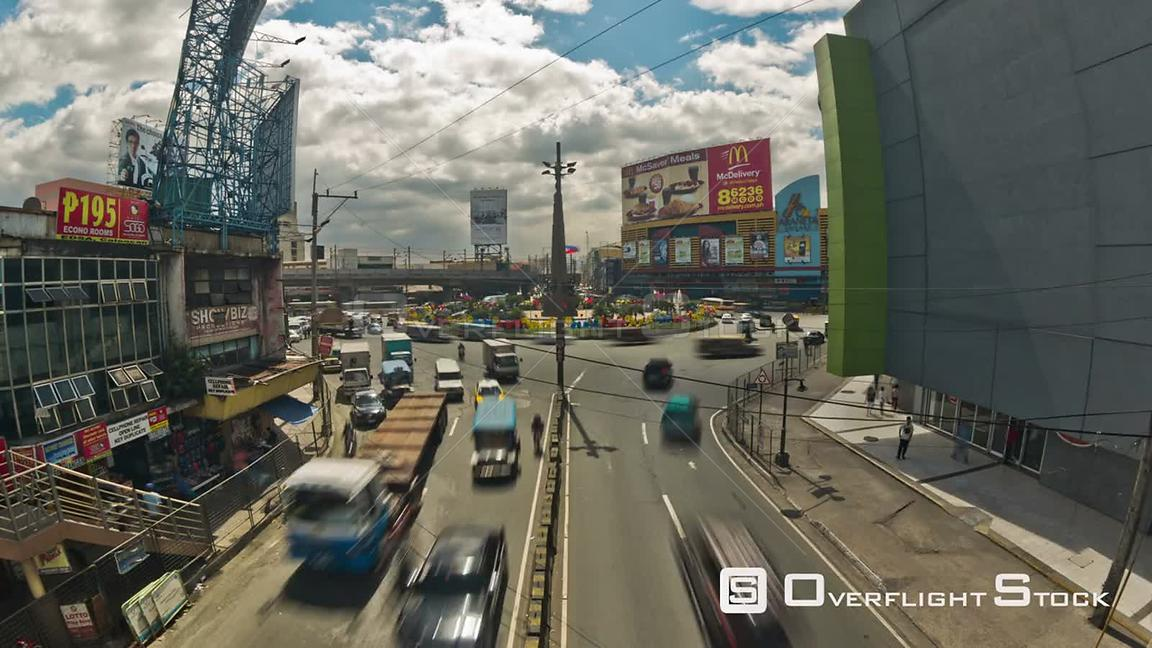 City traffic time lapse of busy Araneta Square in Manila Pilippines