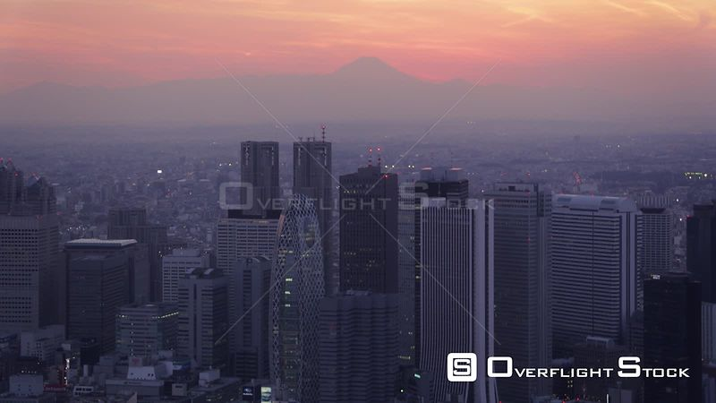 Japan Tokyo Aerial Flying over downtown Shinjuku area with cityscape views night
