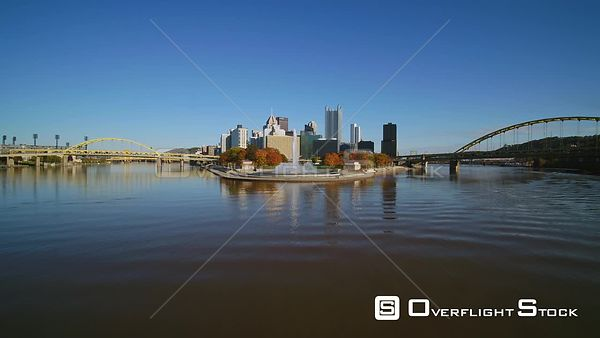 Pittsburgh Pennsylvania Downtown skyline cityscape flying from over water to Point State Park vantage