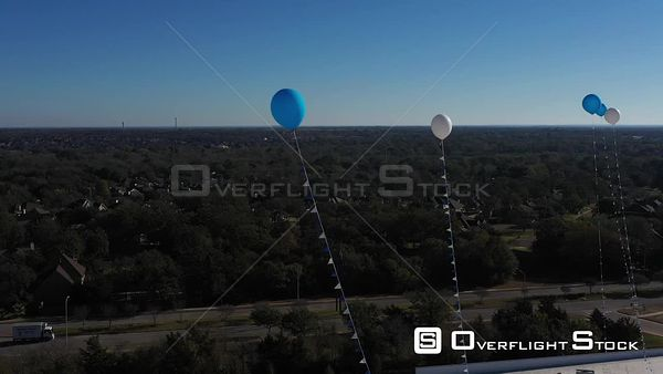 Balloons Floating on Tethers in a Blue Sky, Bryan, Texas, USA