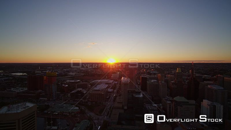 Baltimore Maryland Aerial Downtown cityscape at sunset moving backwards, dark blue hour