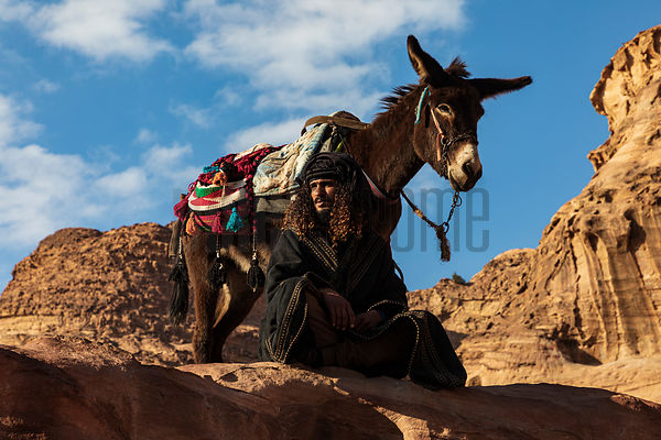 A Bedhouin Sits with his Donkey at the Monastery at Petra
