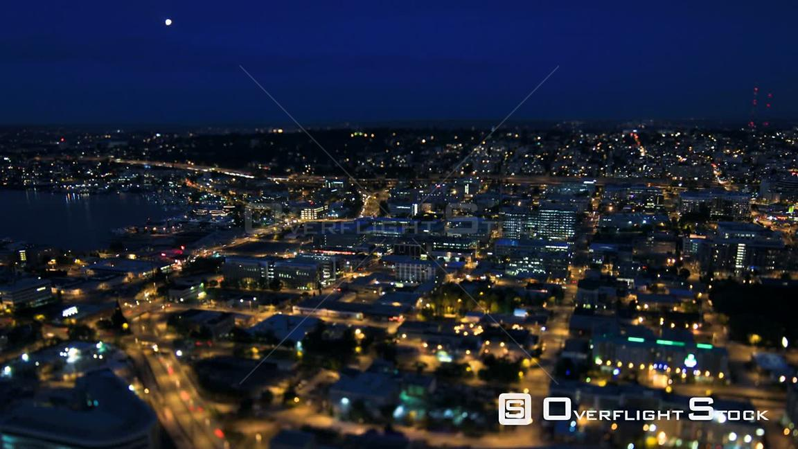 Seattle Washington State USA Seattle city traffic time lapse at night using a tilt shift lens with a horizontal center in focus.