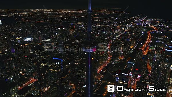Toronto Ontario Panning birdseye cityscape at night with CN Tower light show
