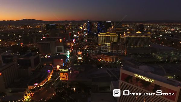 Side view low flying aerial over strip. Las Vegas Nevada