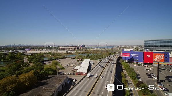 NYC New York Flying low panning around Flushing Meadows Corona Park cityscape with expressway view