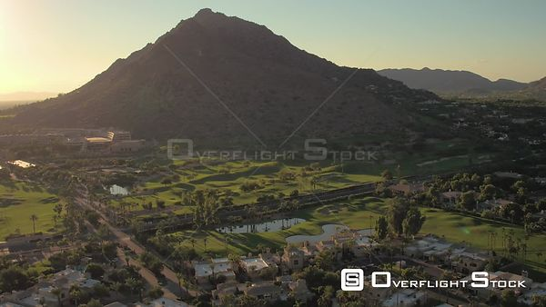 Phoenix Arizona Aerial Flying low over Phoenician Golf Club area panning sunset