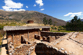 Water channel and building behind large boulder or huaca at Inca site of Urco / Urqo near Calca, Cusco Region, Peru