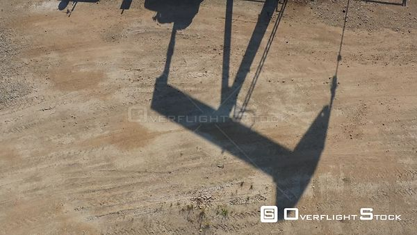 Shadow of an oil well pump jack, Burleson County, Texas, USA