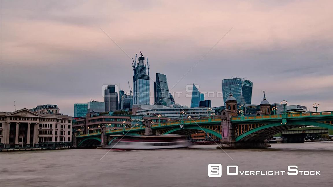 Timelapse view of the City of London at sunset across the river Thames