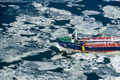 Winter Ice and Ship on St Lawrence River Quebec Canada