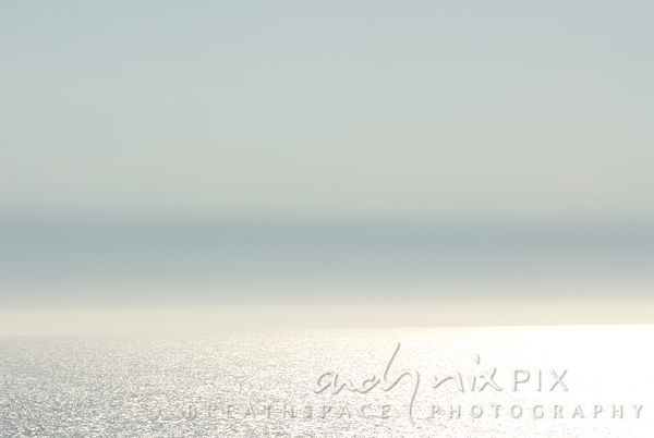 Bright sunlight sparkling on sea, abstract, blank