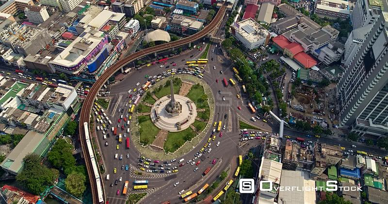 Thailand Bangkok Aerial Panning birdseye above Victory Monument to cityscape view