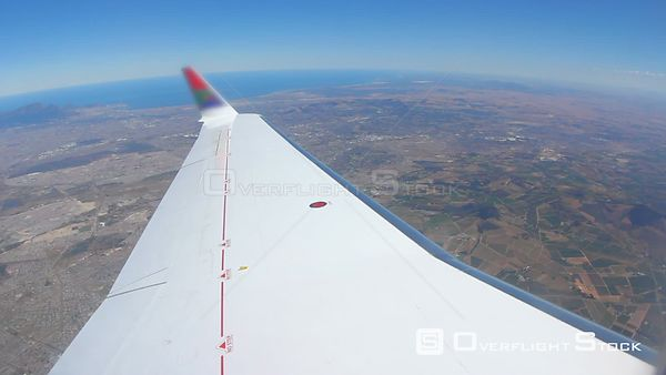 Fisheye shot of flying with Cape Town  below in background. South Africa