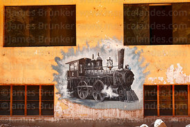 Mural of steam engine on wall of house in Pachar, Sacred Valley, Peru