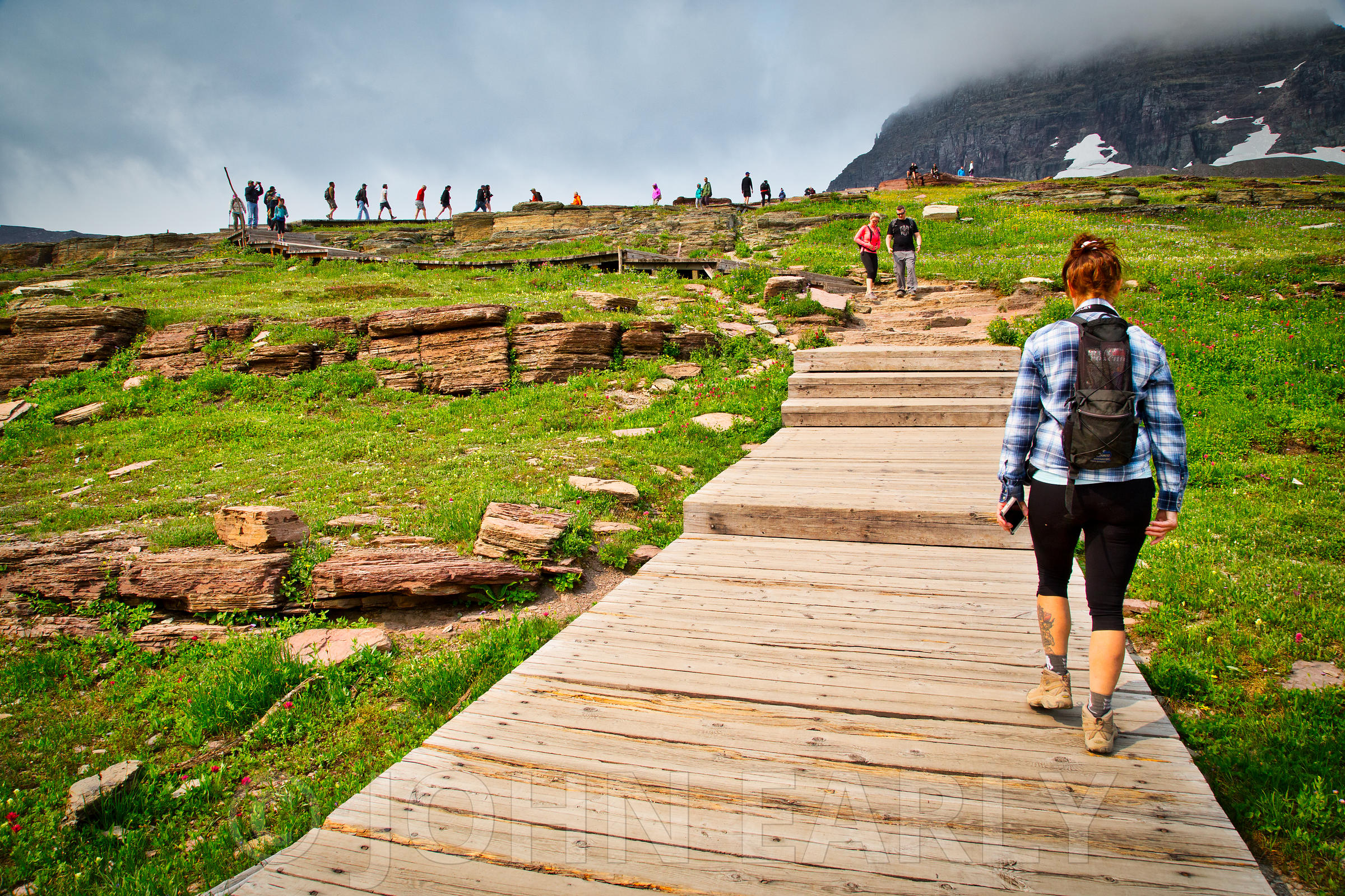 Hikers heading up the Hidden Lake Trail from Logan Pass.